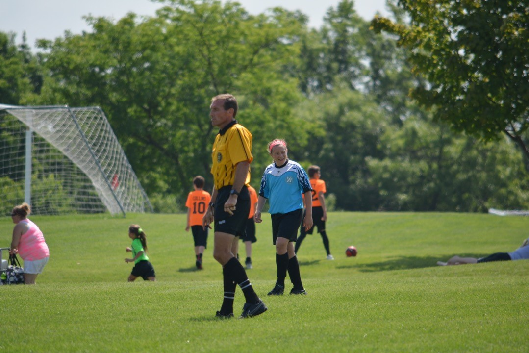 Vaughn, seen here working a game for the local youth league in Iowa