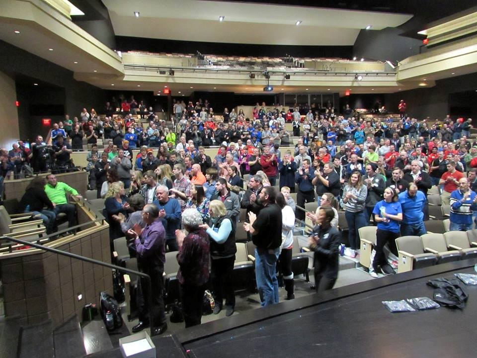 With the announcement that the Referee Academy he founded is being named in his honor, Vaughn (left, in green) receives a standing ovation at the 2016 Terry Vaughn Referee Academy. (Photo Courtesy Iowa Referee Committee)